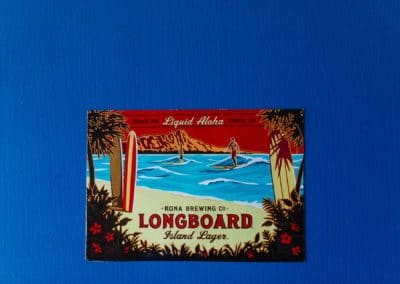 Longboard hawaiian beer sign on a blue door