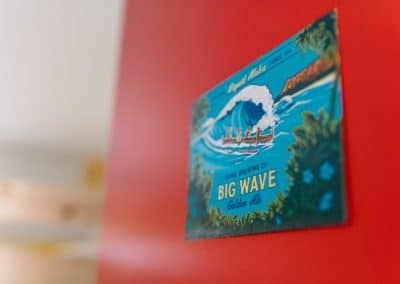 big Wave hawaiian beer sign on a red door