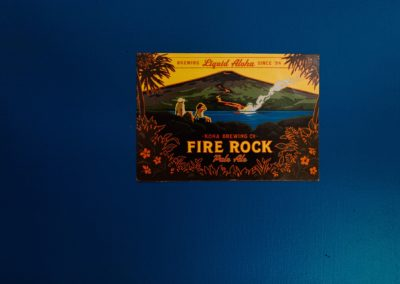 Fire Rock Hawaiian beer sign on a blue door