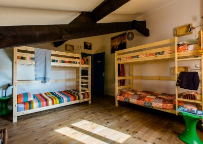 bright attic bedroom with 2 wood bunk beds