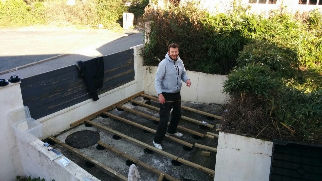 Guy working on a concrete patio