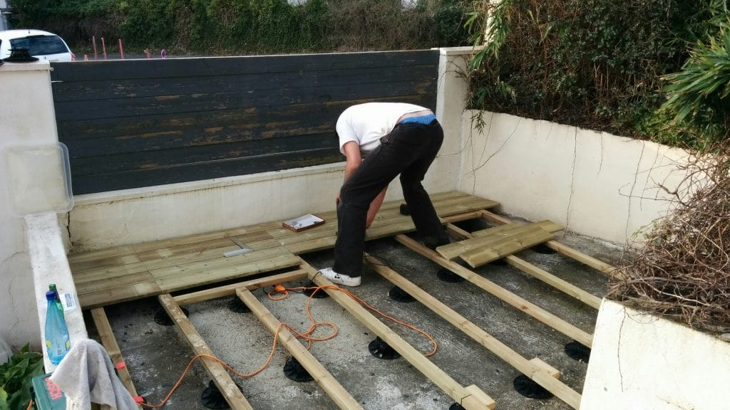 Worfer building a wood patio