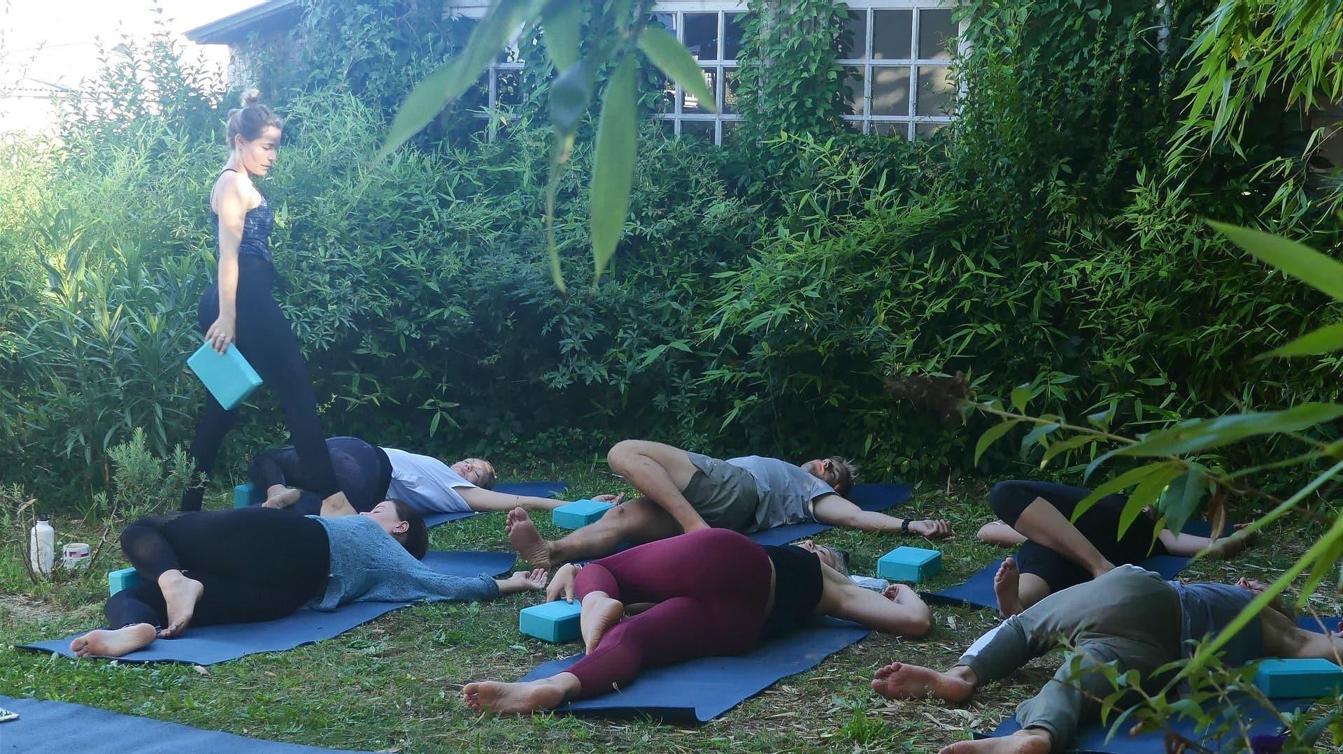 yoga class in the garden of nami house hostel