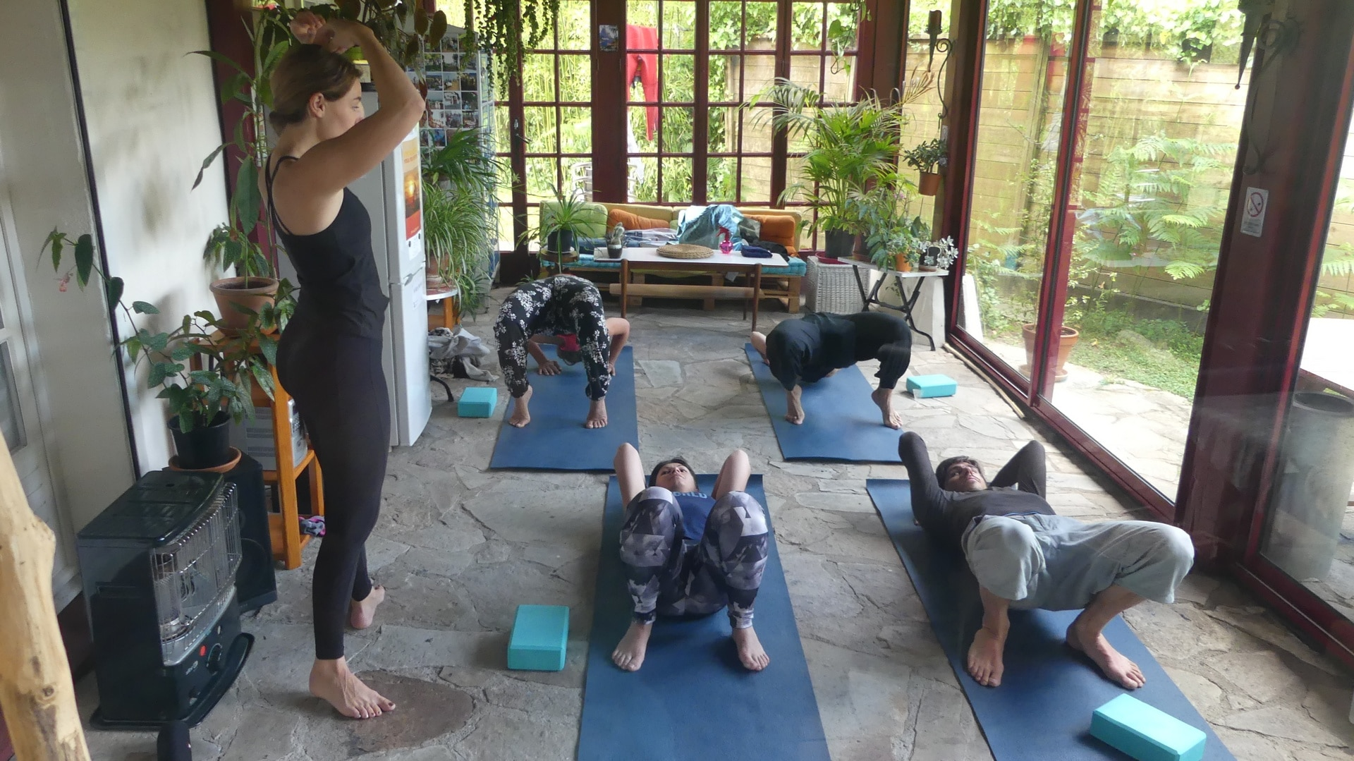 Indoor yoga class in Nami House's sunroom