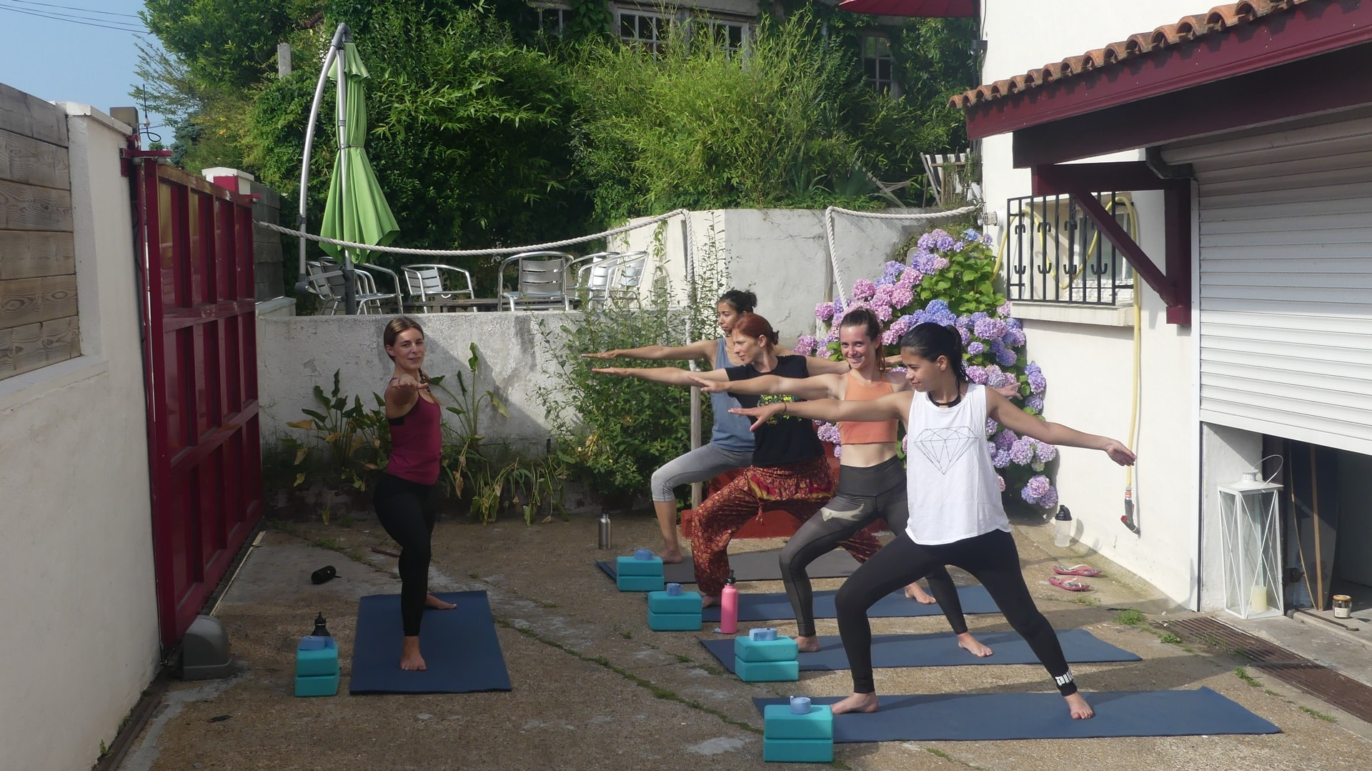 outdoor yoga class in Nami House's garden
