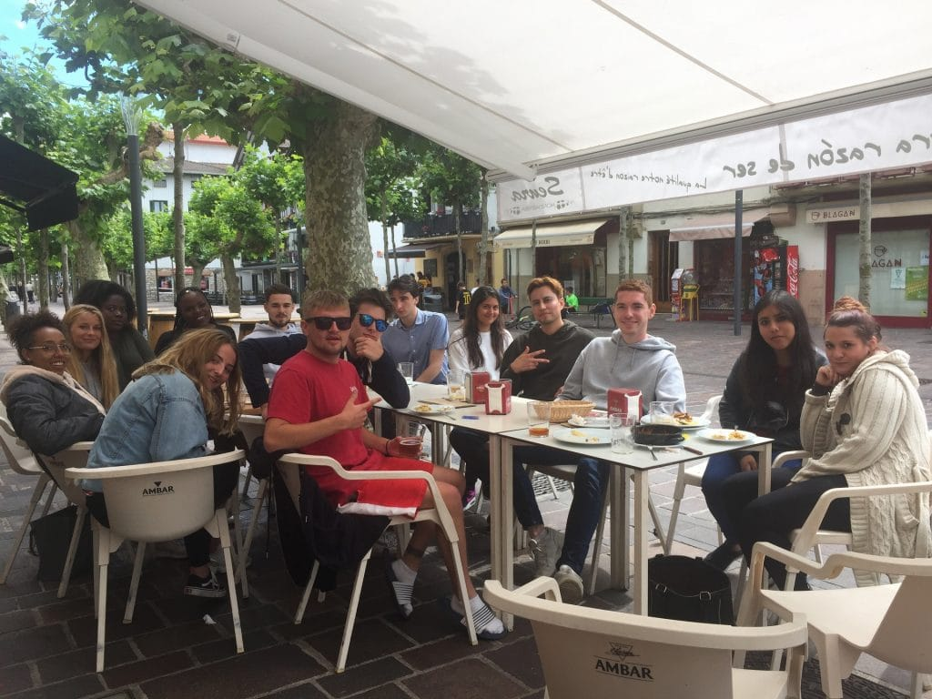 group of youg people having lunch at a terrace in biarritz